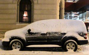 "snow on car with ""I love New York"" Graffiti."